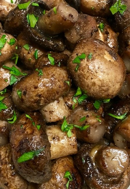 Easy Sautéed Mushrooms Recipe - Close-up of Baby Bella mushrooms sprinkled with chopped parsley
