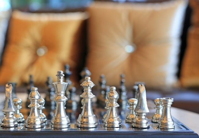 Chess board in front of a sofa