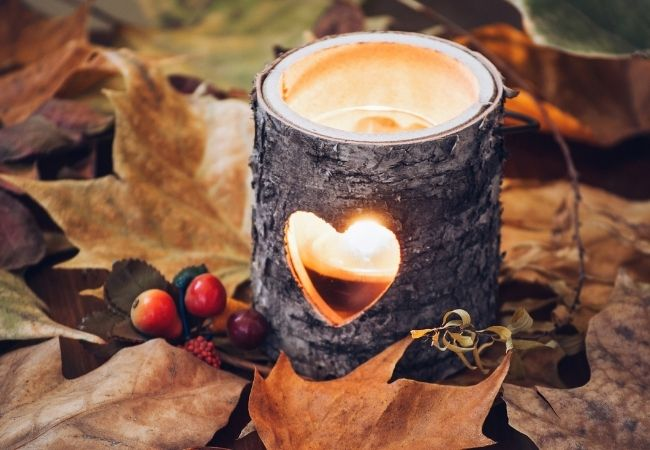 Fall candle with autumn leaves