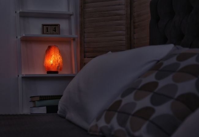 Bedroom in dark with a salt lamp lighting the room