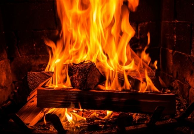 Close-up of fireplace with fire roaring