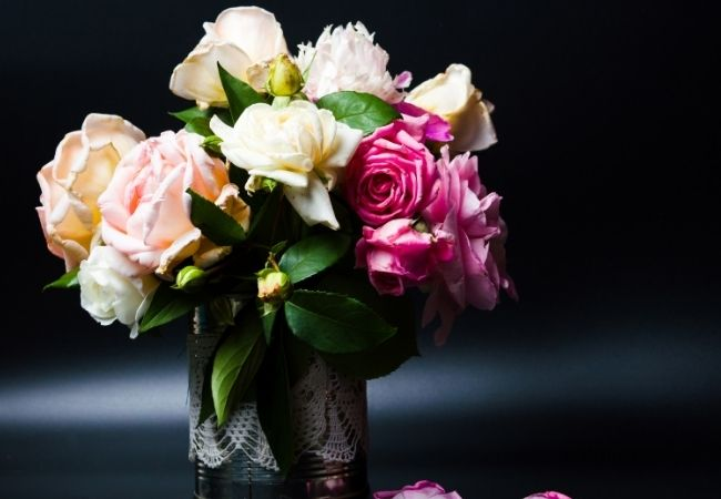 Vases of fresh roses in different colors