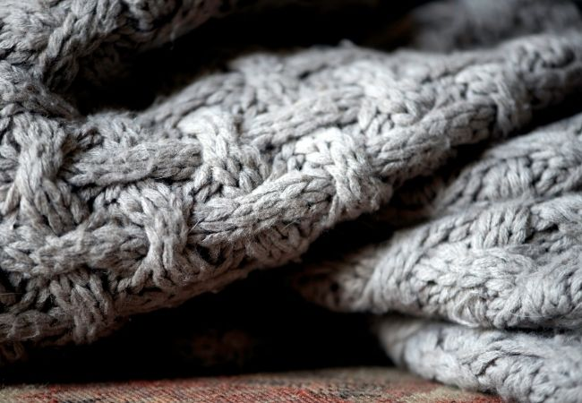 Close-up photo of a gray blanket