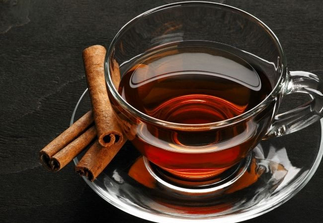 Cup of Cinnamon Tea with Cinnamon Sticks