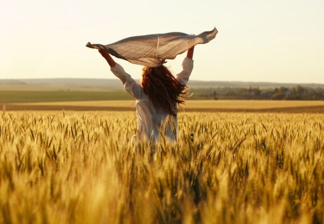 Back of a Woman in a wheat field