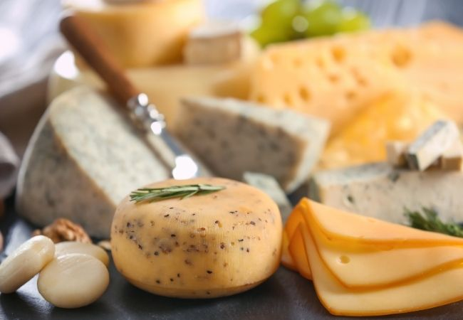 Easy Charcuterie Board Ideas - a variety of cheese and a knife