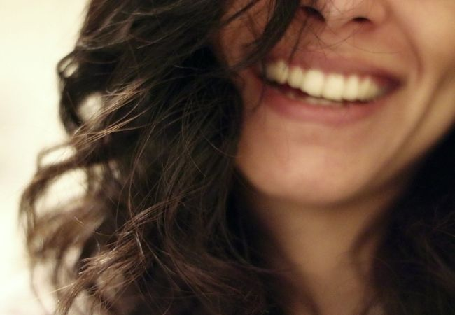 Close-up of a woman's smile and hair