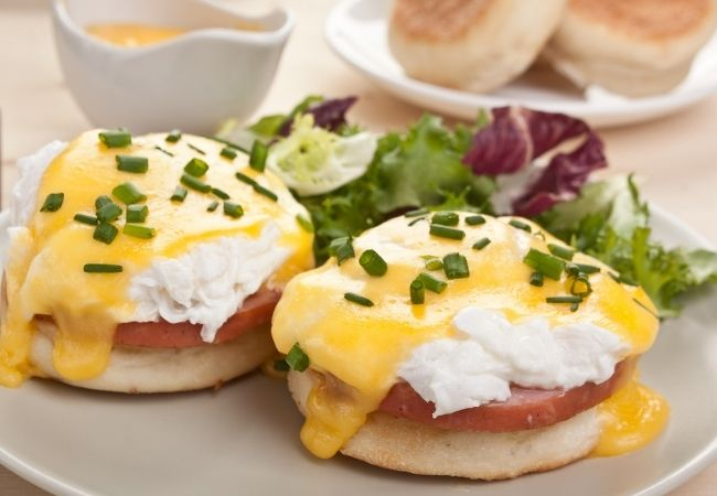 Minced chives topping eggs Benedict