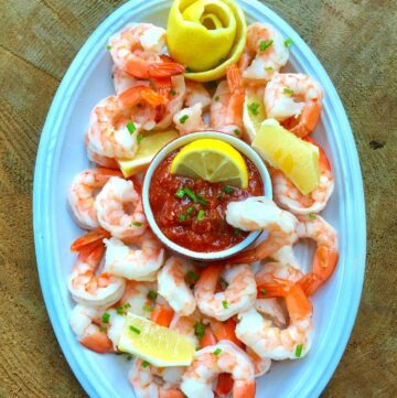 How to Make Cocktail Sauce for Shrimp in a bowl surrounded by shrimp