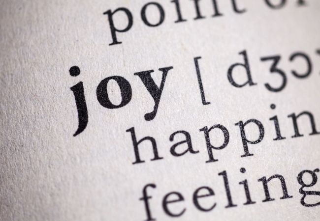 "A close-up of the word ""Joy"" in the dictionary"