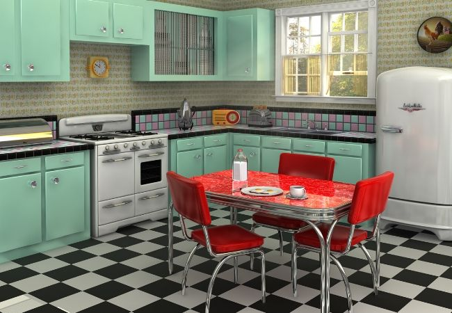 Themed Family Dinner Night Ideas - 1950's Kitchen with turquoise cabinets and a retro refrigerator and a red dining table and chairs on checkered black and white flooring