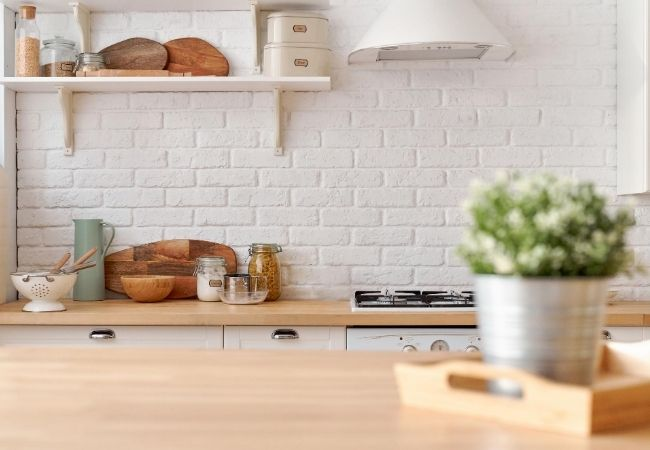 Simple Kitchen with White Brick Wall and Minimal Clutter
