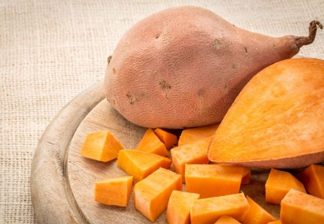 Cut up Sweet Potatoes on a Cutting Board