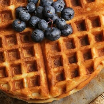 Close-up Buttermilk Waffles with Fresh Blueberries on Top