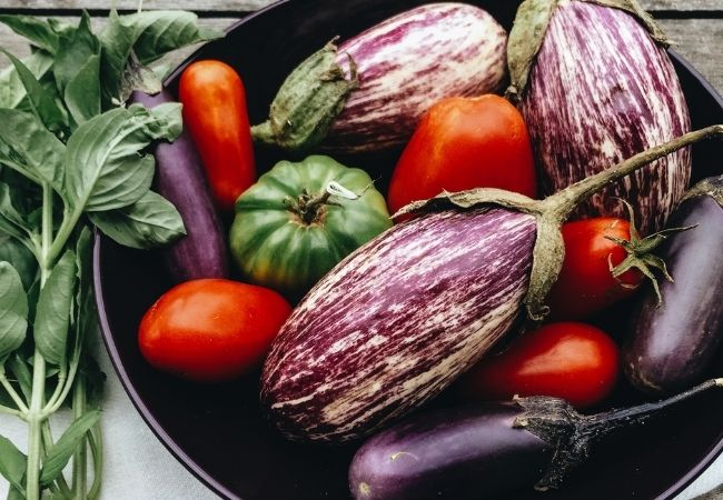 Heirloom tomatoes an eggplants in cast iron pan