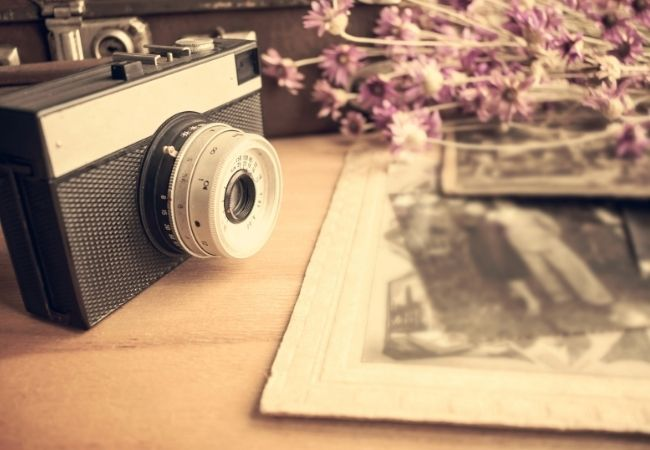 Vintage camera with old-fashioned photos and dried lavender