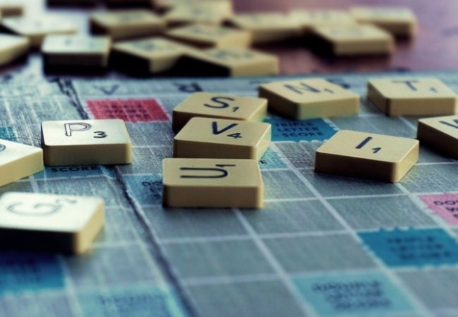 Scrabble board with wooden letters on top - Hygge Hobbies Idea