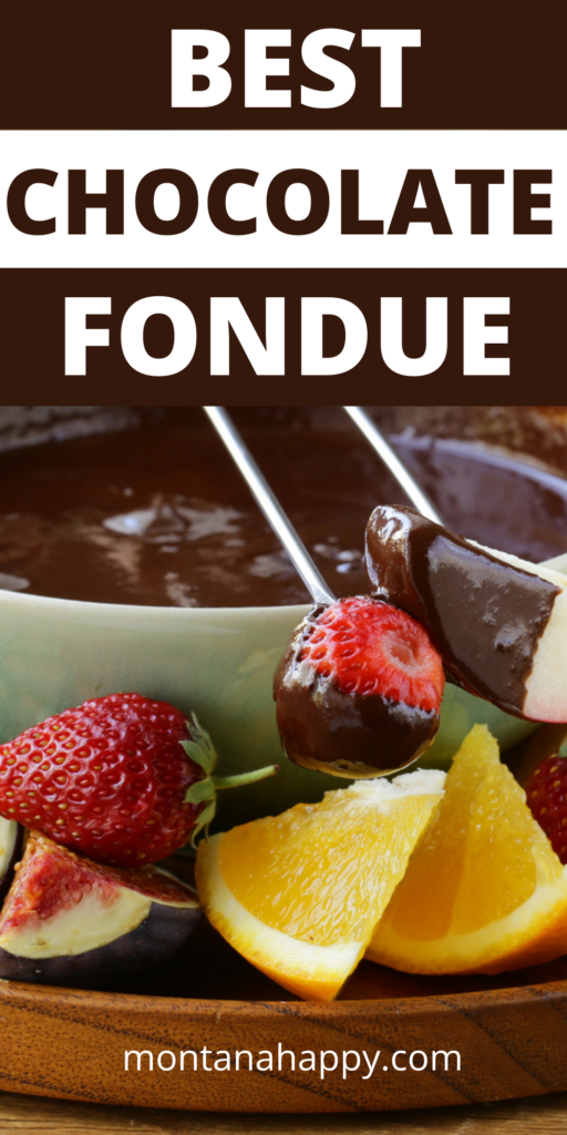 Best Chocolate Fondue Recipe text overlay Pin for Pinterest - close-up of bowl of chocolate fondue with two fondue forks laying on top on a plate of sliced fresh fruit.