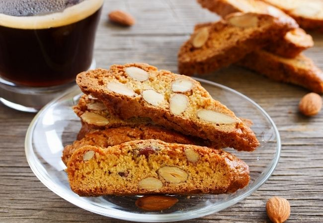 Easy Chocolate Fondue Recipe Ideas - Almond Biscotti on a plate with coffee in the background