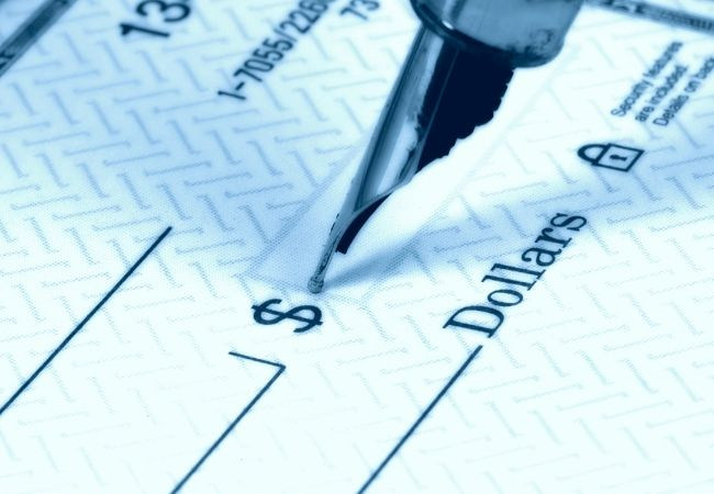 Checkbook with fountain pen.  Save money by doing a bill audit