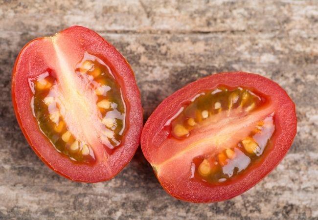 Grape tomatoes sliced in half.