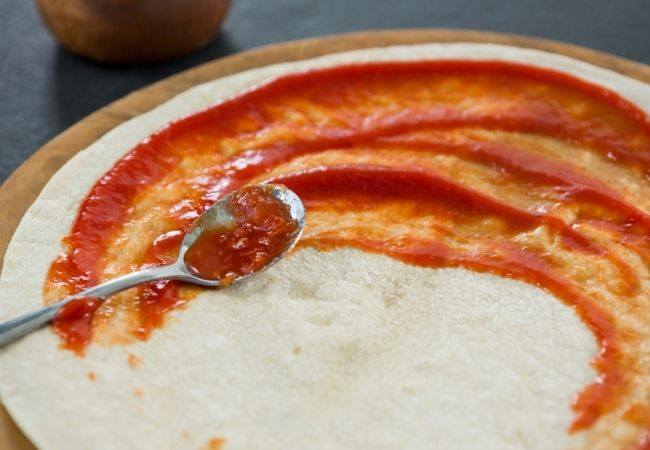 Homemade Pizza Sauce on a Pizza Crust
