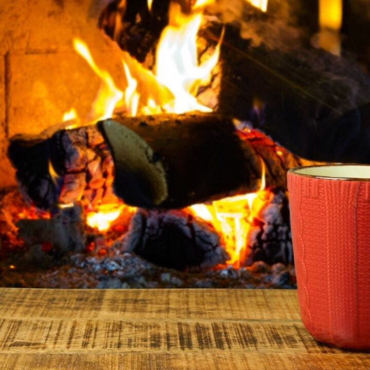 31 Hygge Quotes to Soothe Your Soul - Orange Mug on Table in front of fireplace