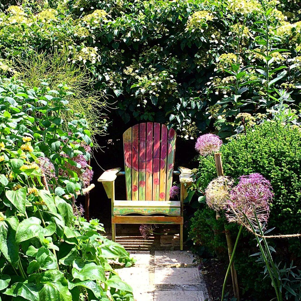 Fun Ideas for Garden Decor - Hand painted Chair in a Nook in the Garden