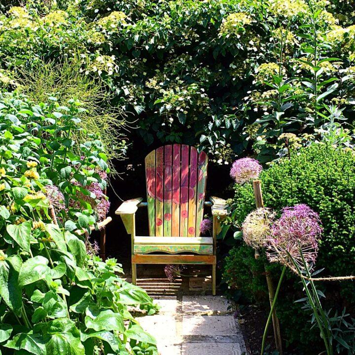 Fun Ideas for Garden Decor - Hand painted Chair in the Nook of a Garden