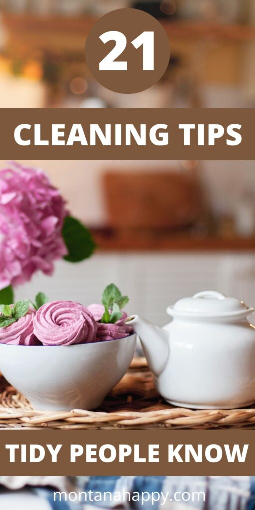 21 Secrets to Keeping a Tidy Home - Pin for Pinterest - wicker tray with white teapot, bowl of treats, and vase of flowers in front of a kitchen