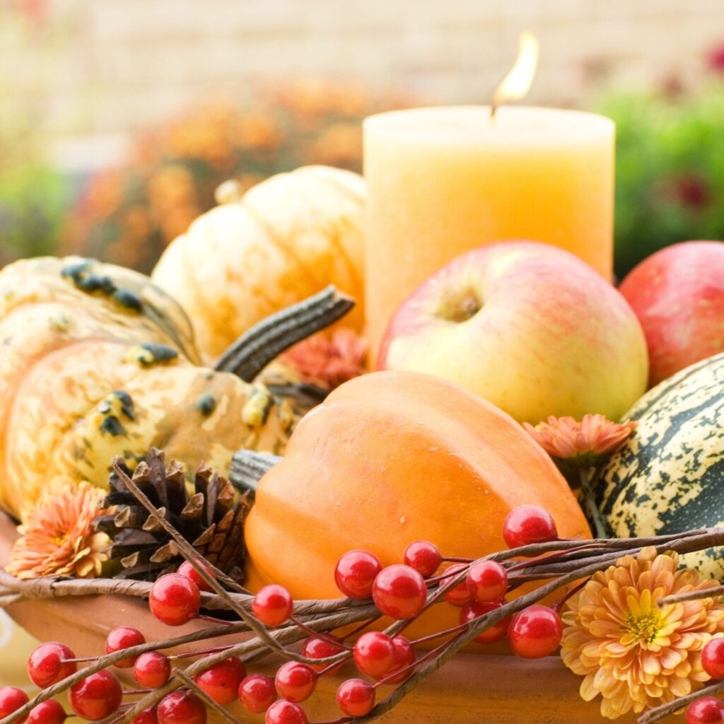 Autumn decorating with gourds and pumpkins. Fall Candle Holder with pumpkins, gourds, and apples.