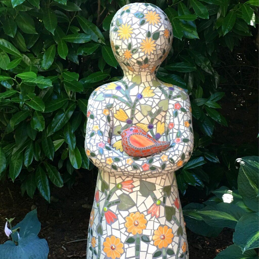 Garden Art - Mosaic Statue of a child holding a bird