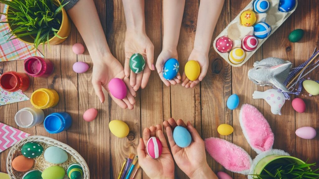 Hygge Holiday Ideas - Easter table with children painting eggs