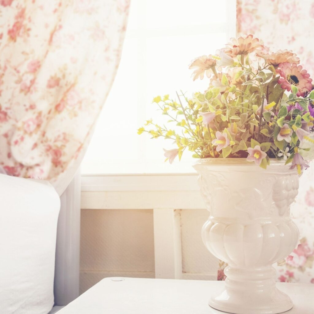 Ideas on Keeping Your House Clean and Tidy - Let the Sunshine in - Window with floral curtains and a vase of flowers