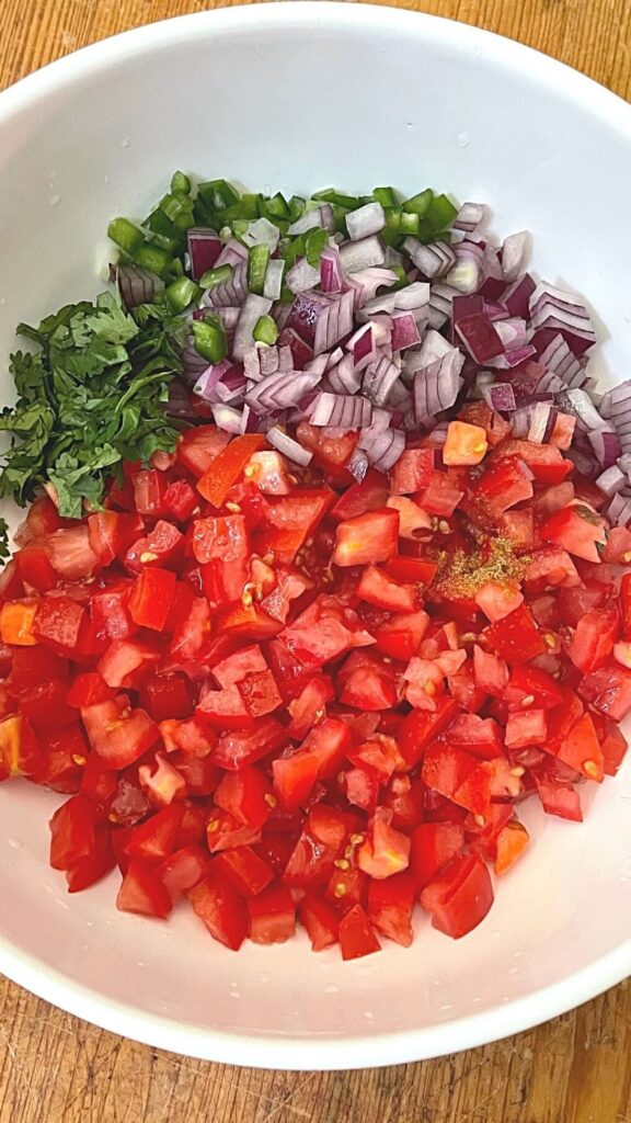 Ingredients for Salsa Fresca in a White Bowl