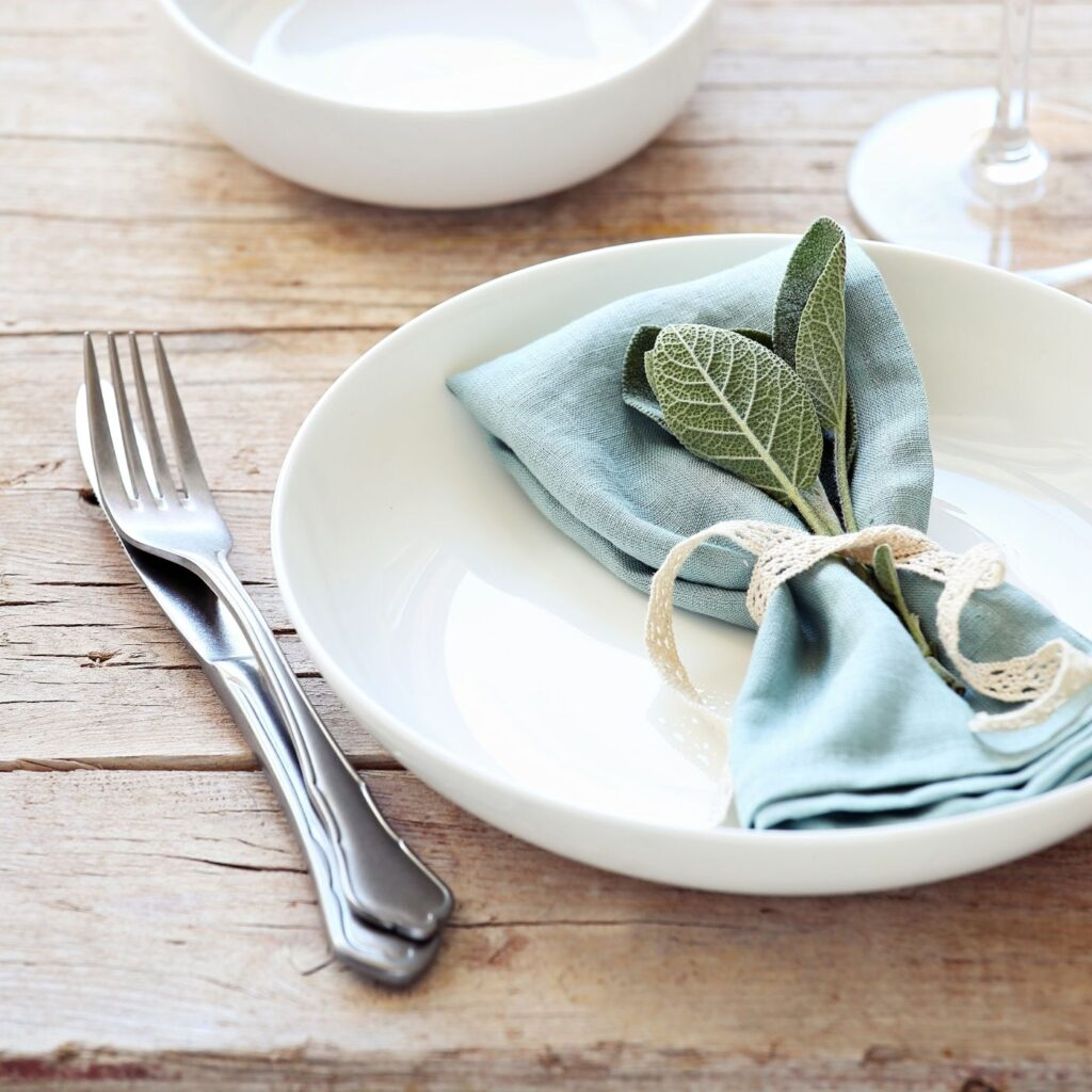 Tidy Home Dining Table with one place setting, napkin and silverware
