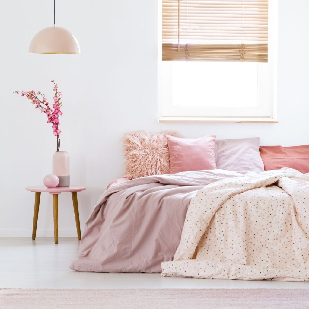 Tidy house plan - Bed with pillows and a side table in pastel hues