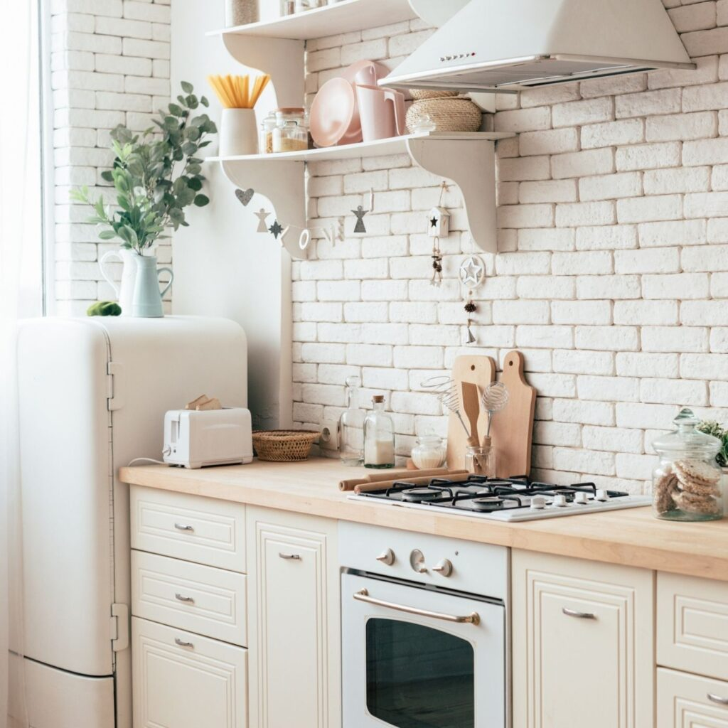 Tidy kitchen with a white brck wall