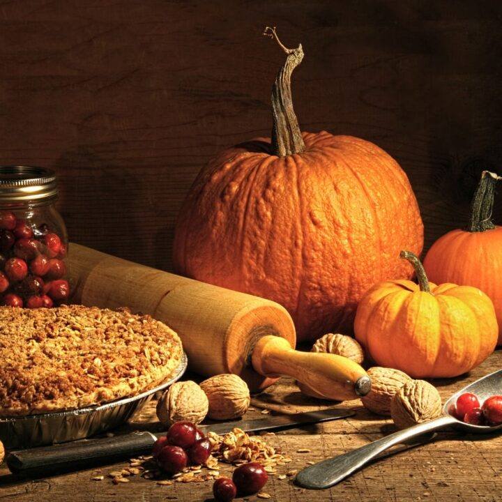 Best Thanksgiving Traditions for family and friends - pumpkins with rolling pin, eggs, pie, and jar of cranberries