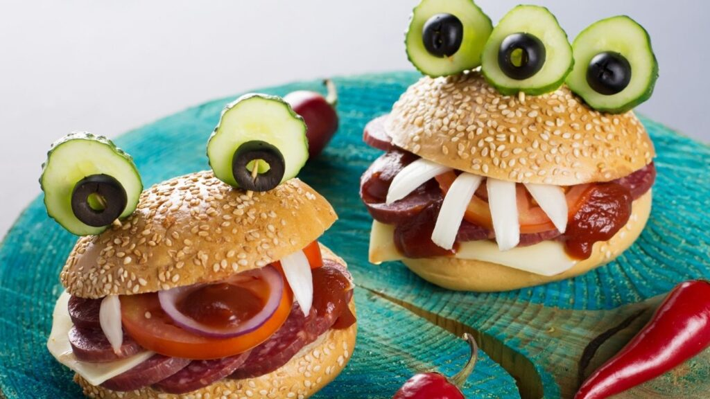 Halloween monster sandwiches with eyes and fangs