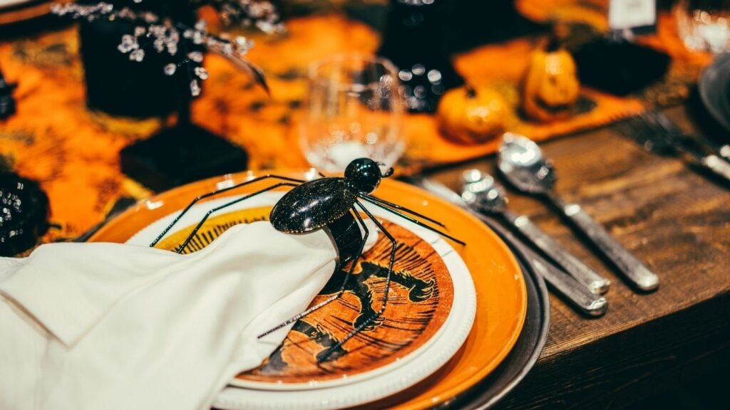 Halloween place setting with a black spider napkin ring.