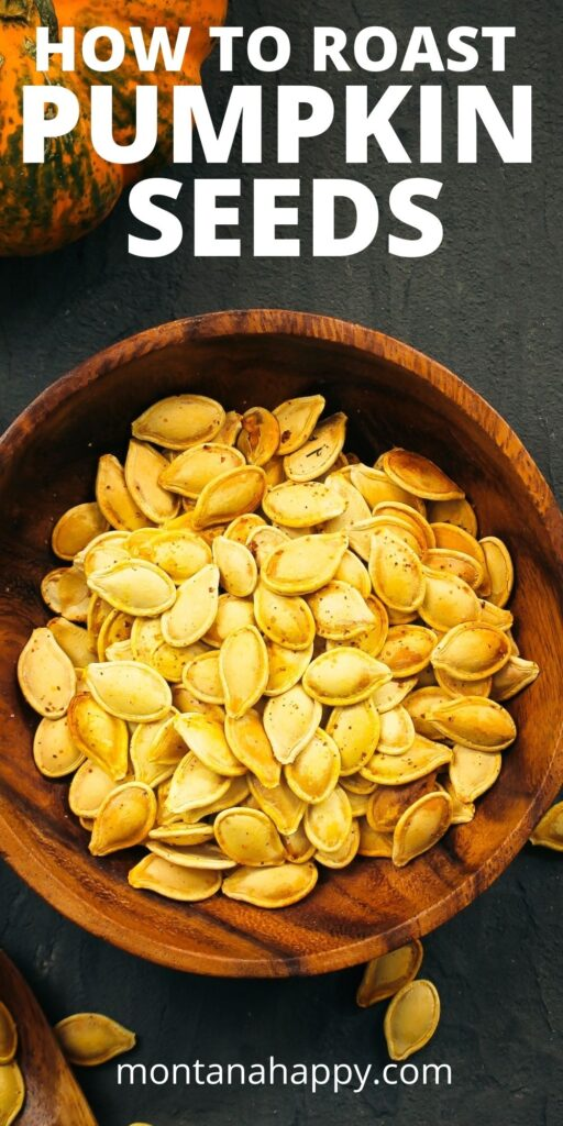 How to Roast Pumpkin Seeds - Pin for Pinterest.  Dark gray background with wooden bowl with roasted pumpkin seeds.