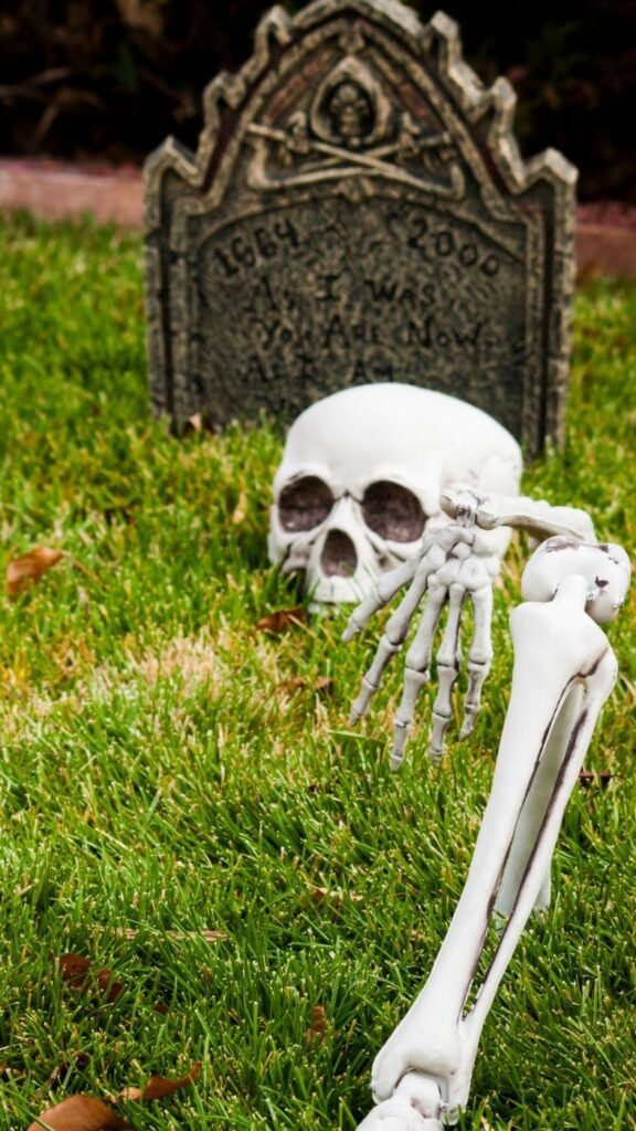 Ideas for Halloween Decor - Skeleton in a graveyard emerging from the ground