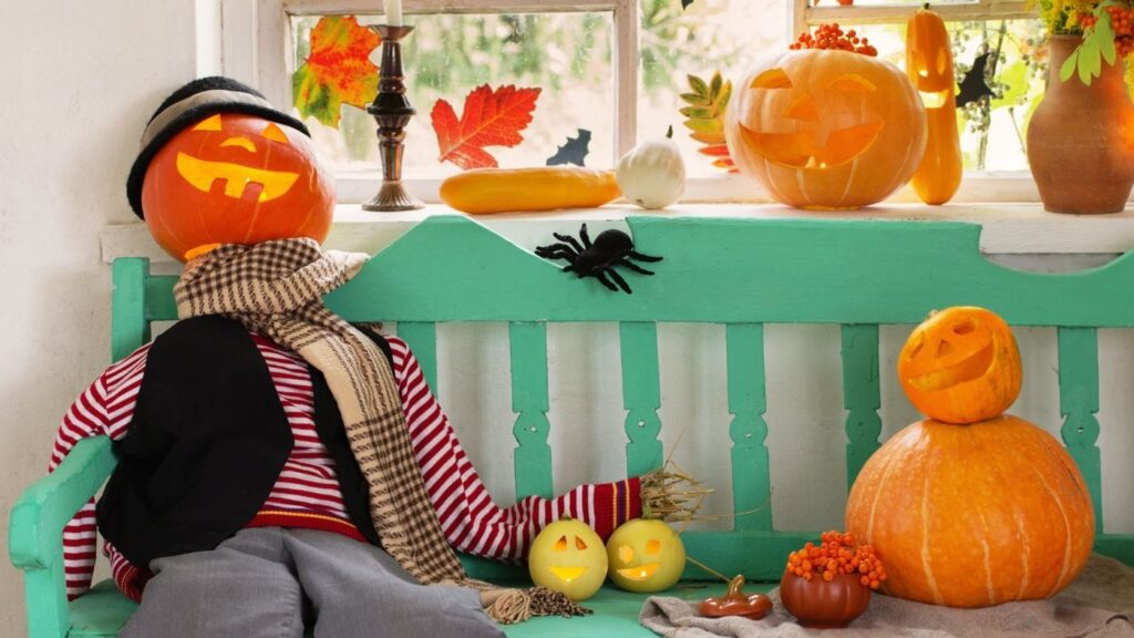 Pumpkin people sitting on a bench