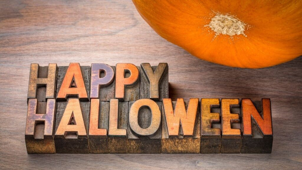 """Simple Ideas for Halloween Decor - Vintage Ink blocks spelling out """"Happy Halloween"""" with a pumpkin"""