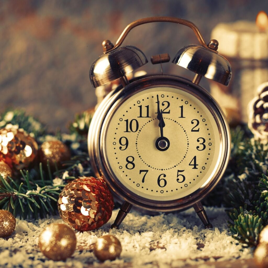 31 Hygge New Year's Resolution Ideas - Vintage Alarm clock with garland and candles