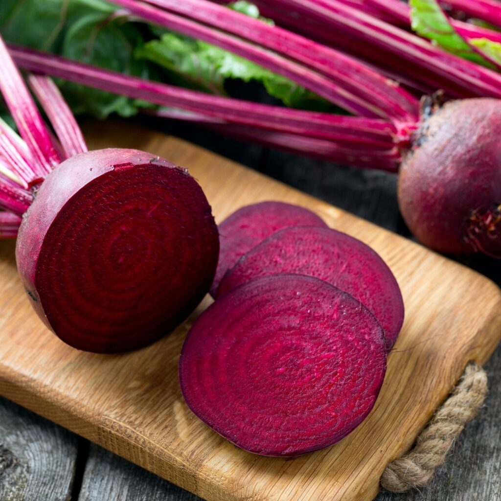 Ingredients for Orange Carrot Beet Juice Recipe - Fresh beets with greens