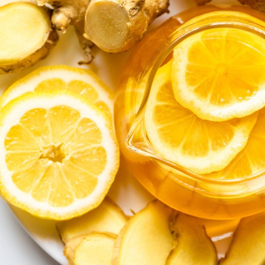 Homemade Detoxing Lemon Ginger Tea Recipe overhead view in a teapot with fresh sliced lemons